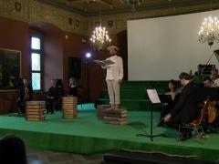 """Florianas Justas (piemuo Tirsis) ir ansamblis """"Canto Fiorito"""". Organizatorių nuotr."""
