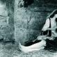 """Audrius Puipa, iš serijos """"Inscenizuoti paveikslai"""". """"Romietės gailestingumas"""" (pagal Rubensą). Pozuoja Monika Bičiūnaitė, Vytautas Kalinauskas. 1994 m. G. Trimako nuotr."""