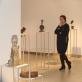 Renginio sumanytoja Zita Bružaitė, fone – Donelaičiui skirta skulptūrų paroda. R. Danisevičiaus nuotr.