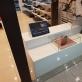 """Parodos """"200 batų – 700 metų"""" reklama batų parduotuvėse."""