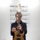 """Artūras Raila, prie kūrinio """"Metalo pjūklas degančiam medžiui"""" fragmento. Partitūra remiasi 1993 m. kūriniu """"80 skaidrių karuseliniam projektoriui"""", ją atliko sunkiojo roko gitaristas Fisheris. Sausio 22 d. 17 val. Nuotrauka iš A.Railos asmeninio archyvo"""