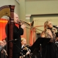 """Jacques Mauger (trombonas, Prancūzija), Marija Arutiunova (sopranas), dirigentas Simon Perčič (Slovėnija), Kauno pučiamųjų instrumentų orkestras """"Ąžuolynas"""". D. Čėplos nuotr."""